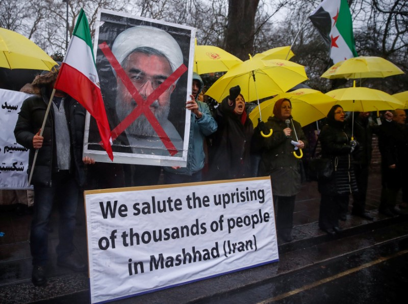 Opponents of Iranian President Hassan Rouhani hold a protest outside the Iranian embassy in west London, Britain December 31, 2017.