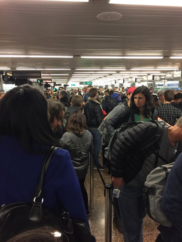 People queue at the immigration lines during a systems outage at Sea-Tac Airport in Seattle, Washington, U.S. in this January 1, 2018 picture obtained from social media