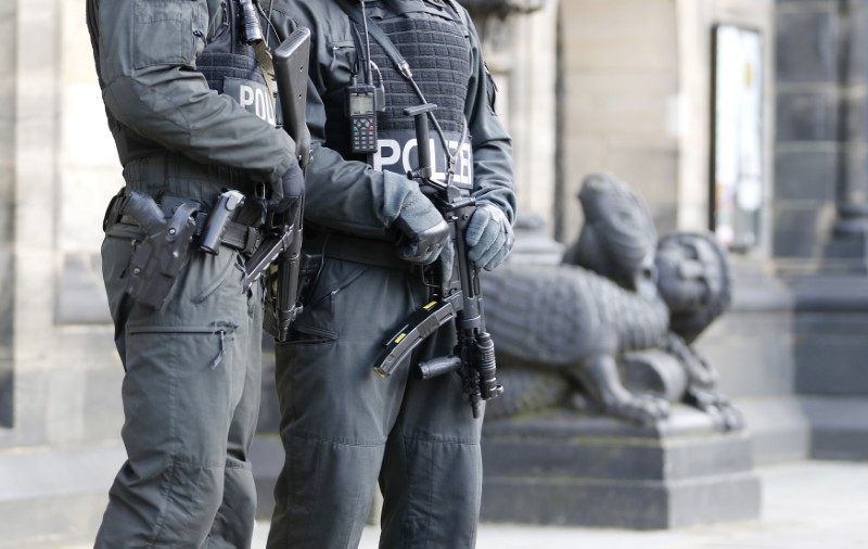 Armed police officers guard 'St. Petri Dome,' next to the town hall of the northern German city Bremen, February 28, 2015.