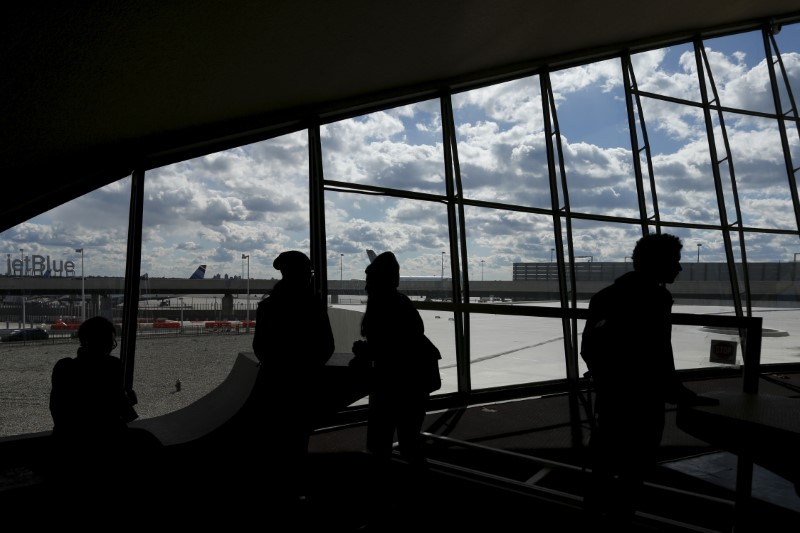 People are seen in silhouette inside the Trans World Airlines Flight Center at John F. Kennedy Airport in the Queens borough of New York, October 18, 2015.