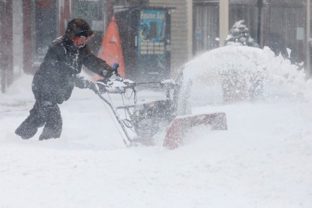 A man uses a snowblower to clear snow from a street during a snowstorm in Port Washington, New York, U.S. January 4, 2018.