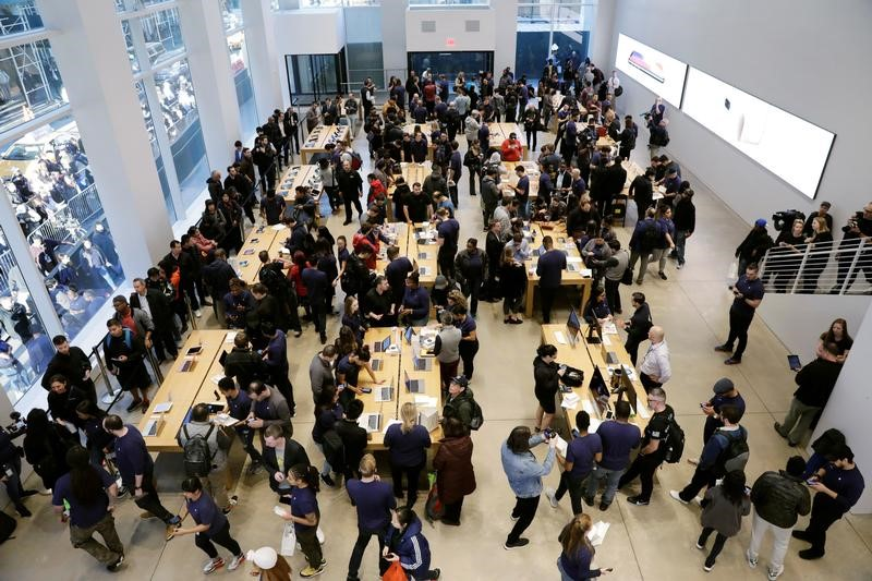 Customers arrive to purchase an iPhone X at an Apple store in New York, U.S., November 3, 2017.