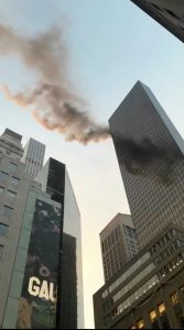 A smoke is seen rising from the roof of Trump Tower.