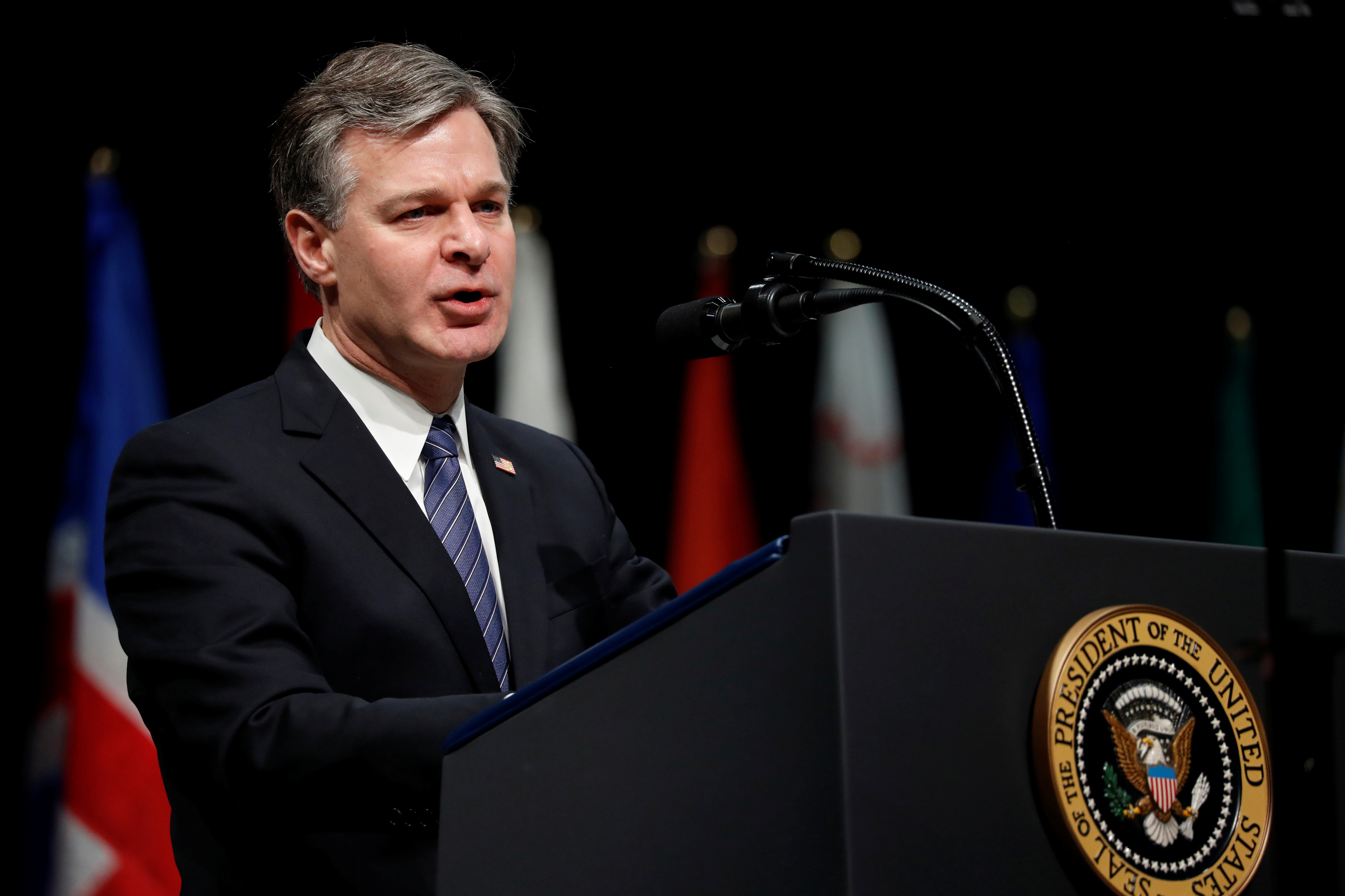FILE PHOTO: FBI Director Christopher Wray delivers remarks to a graduation ceremony at the FBI Academy on the grounds of Marine Corps Base Quantico in Quantico, Virginia, U.S. December 15, 2017.