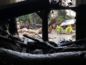 Emergency personnel search through debris and damaged homes after a mudslide in Montecito, California, U.S. in this photo provided by the Santa Barbara County Fire Department, January 9, 2018.