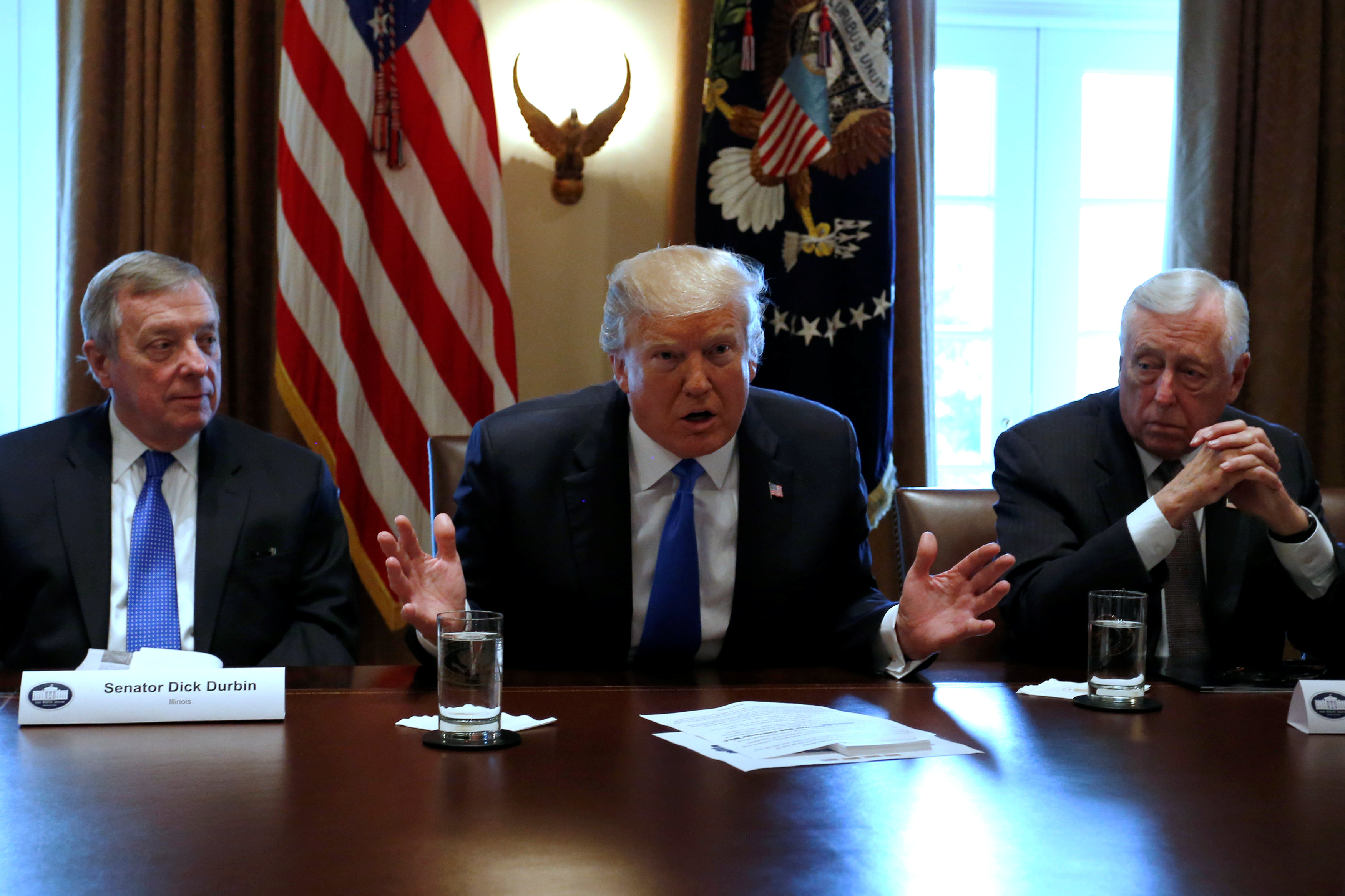 U.S. President Donald Trump, flanked by U.S. Senator Dick Durbin (D-IL) and Representative Steny Hoyer (D-MD), holds a bipartisan meeting with legislators on immigration reform at the White House in Washington, U.S. January 9, 2018. REUTERS/Jonathan