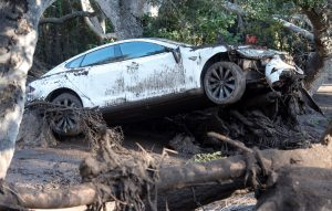 A car sits tangled in debris after being destroyed by mudslides in Montecito, California, U.S., January 10, 2018.