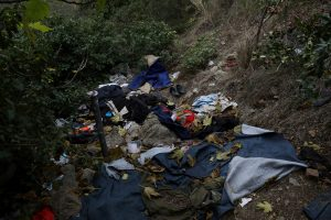 Discarded clothes are seen by a mountain pass near the Italian-French border from where migrants have attempted to pass into France, near the Mediterranean coastal town of Ventimiglia in northern Italy,