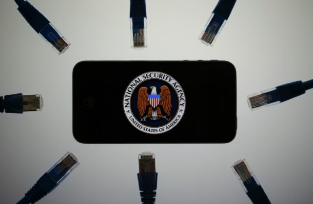 An illustration picture shows the logo of the U.S. National Security Agency on the display of an iPhone in Berlin, June 7, 2013.