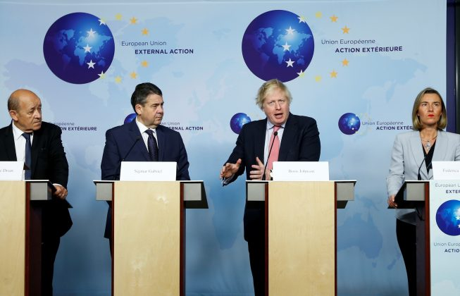 Britain's Foreign Secretary Boris Johnson attends a news conference with French Foreign Minister Jean-Yves Le Drian, German counterpart Sigmar Gabriel and European Union's foreign policy chief Federica Mogherini after meeting Iran's Foreign Minister Mohammad Javad Zarif (unseen) in Brussels, Belgium January 11, 2018.
