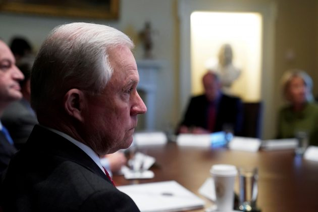 U.S. Attorney General Jeff Sessions listens as U.S. President Donald Trump holds a cabinet meeting at the White House in Washington, U.S., January 10, 2018.