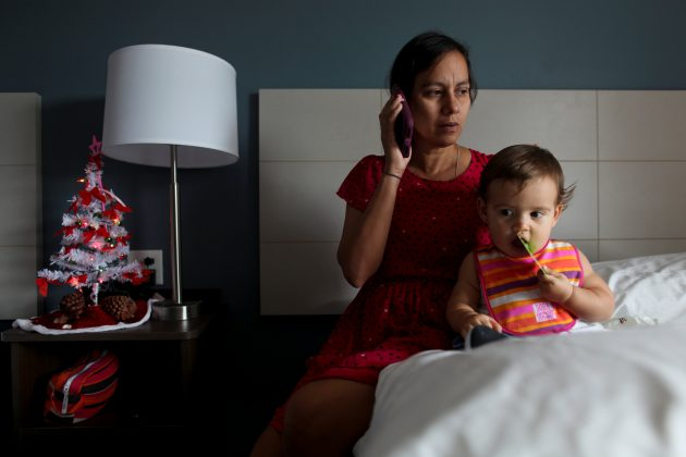 Puerto Rican Debora Oquendo, 43, makes a phone call to a doctor for her 10-month-old daughter in a hotel room where she lives, in Orlando, Florida, U.S., December 4, 2017.