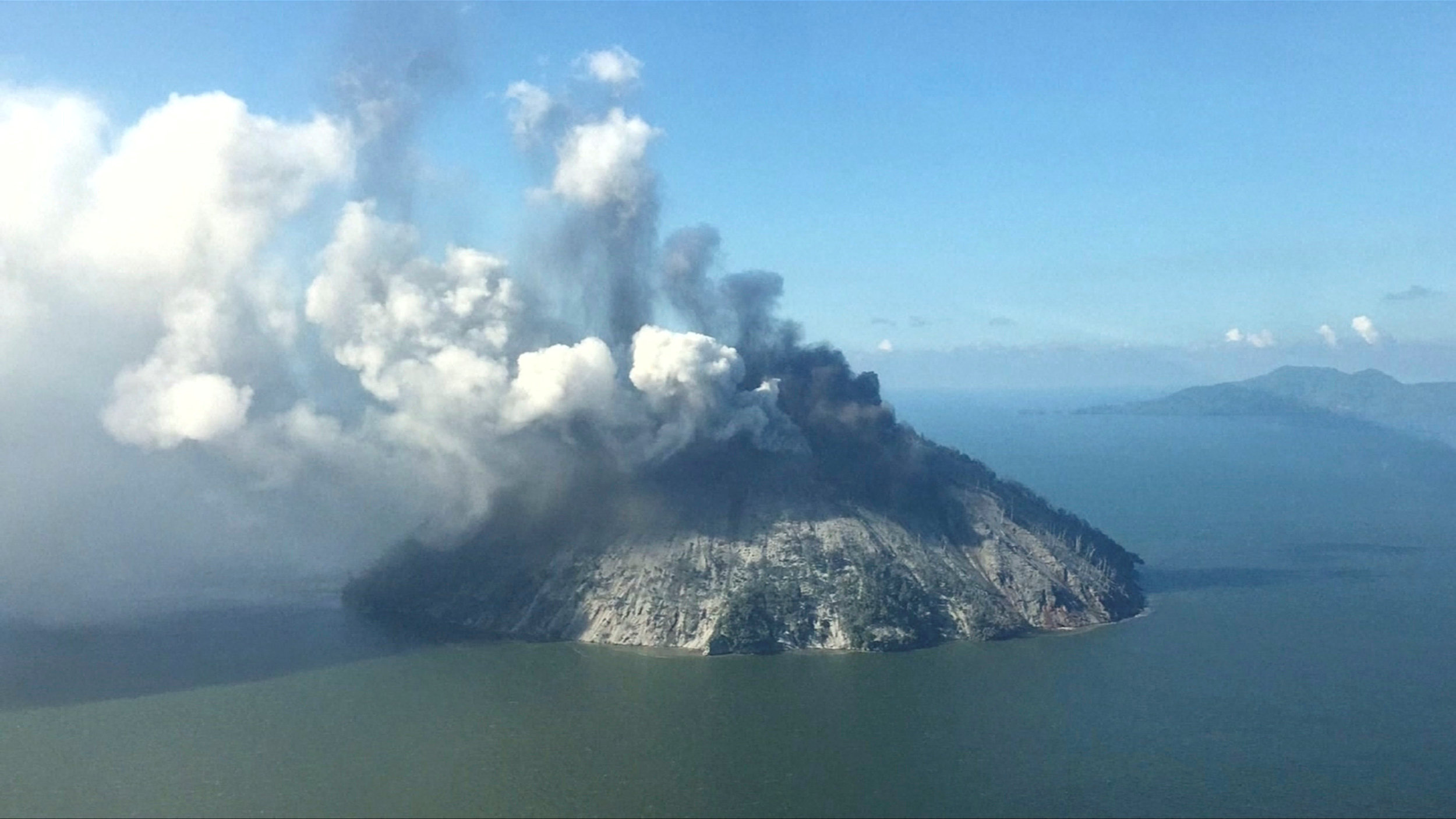 The remote island volcano of Kadovar spews ash into the sky in Papua New Guinea, January 6, 2018. SAMARITAN AVIATION/via REUTERS