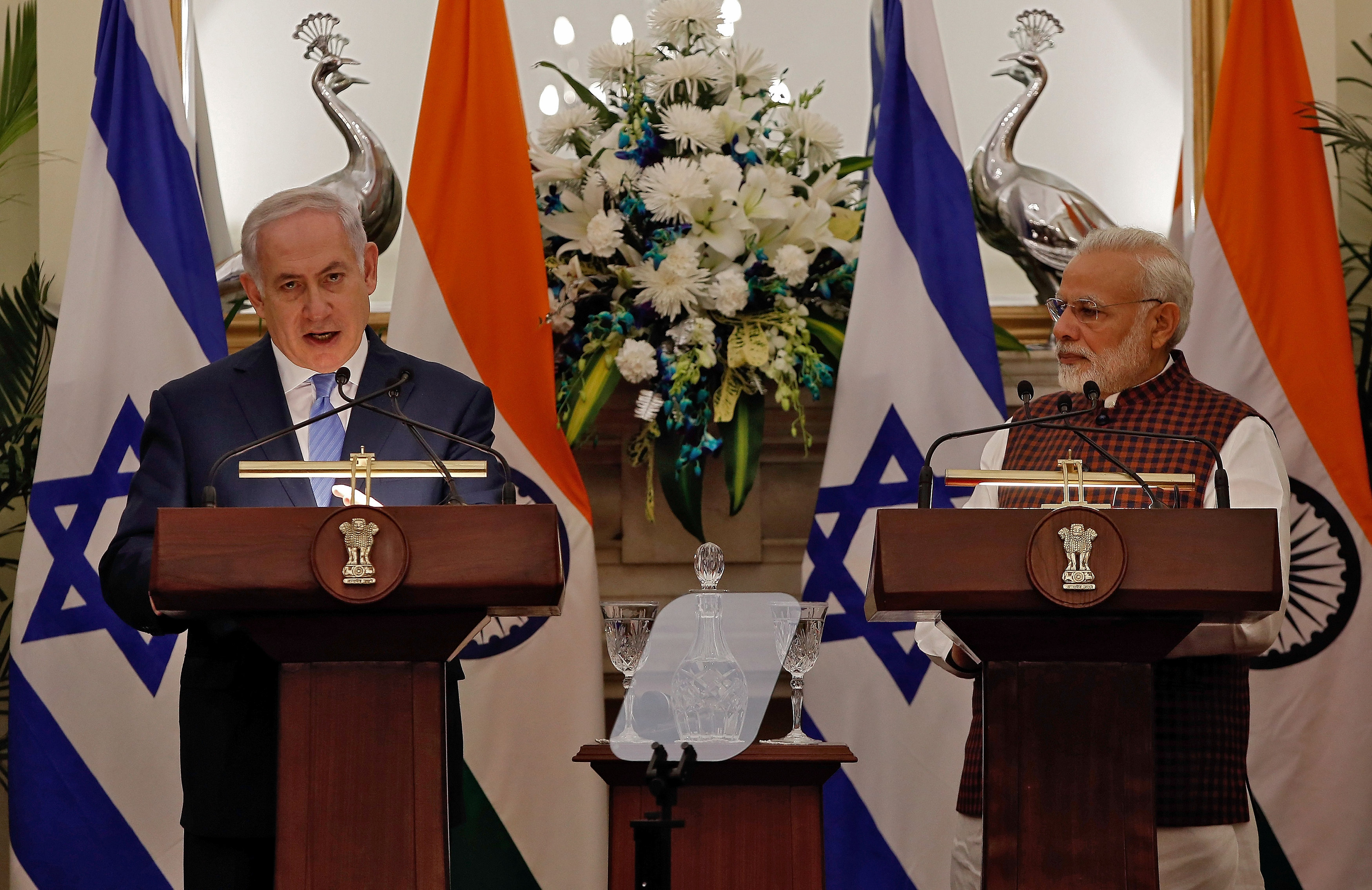 Israeli Prime Minister Benjamin Netanyahu speaks as his Indian counterpart Narendra Modi looks on during a signing of agreements ceremony at Hyderabad House in New Delhi, India January 15, 2018.