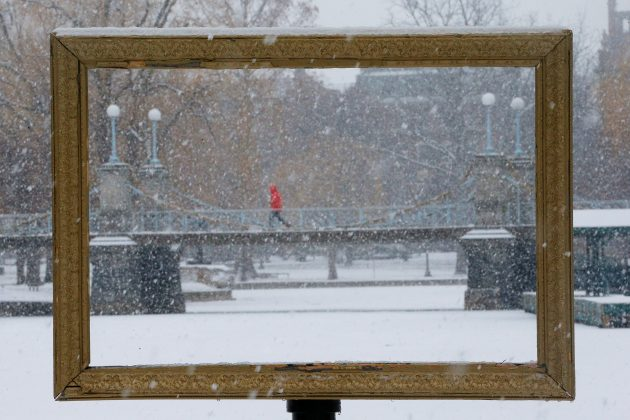 Snow falls through a picture frame in the Boston Public Garden during a winter storm in Boston, Massachusetts, U.S., January 17, 2018.
