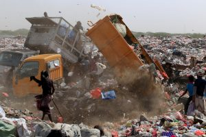 People collect recyclables and food at a garbage dump near the Red Sea port city of Hodeidah, Yemen, January 14, 2018.