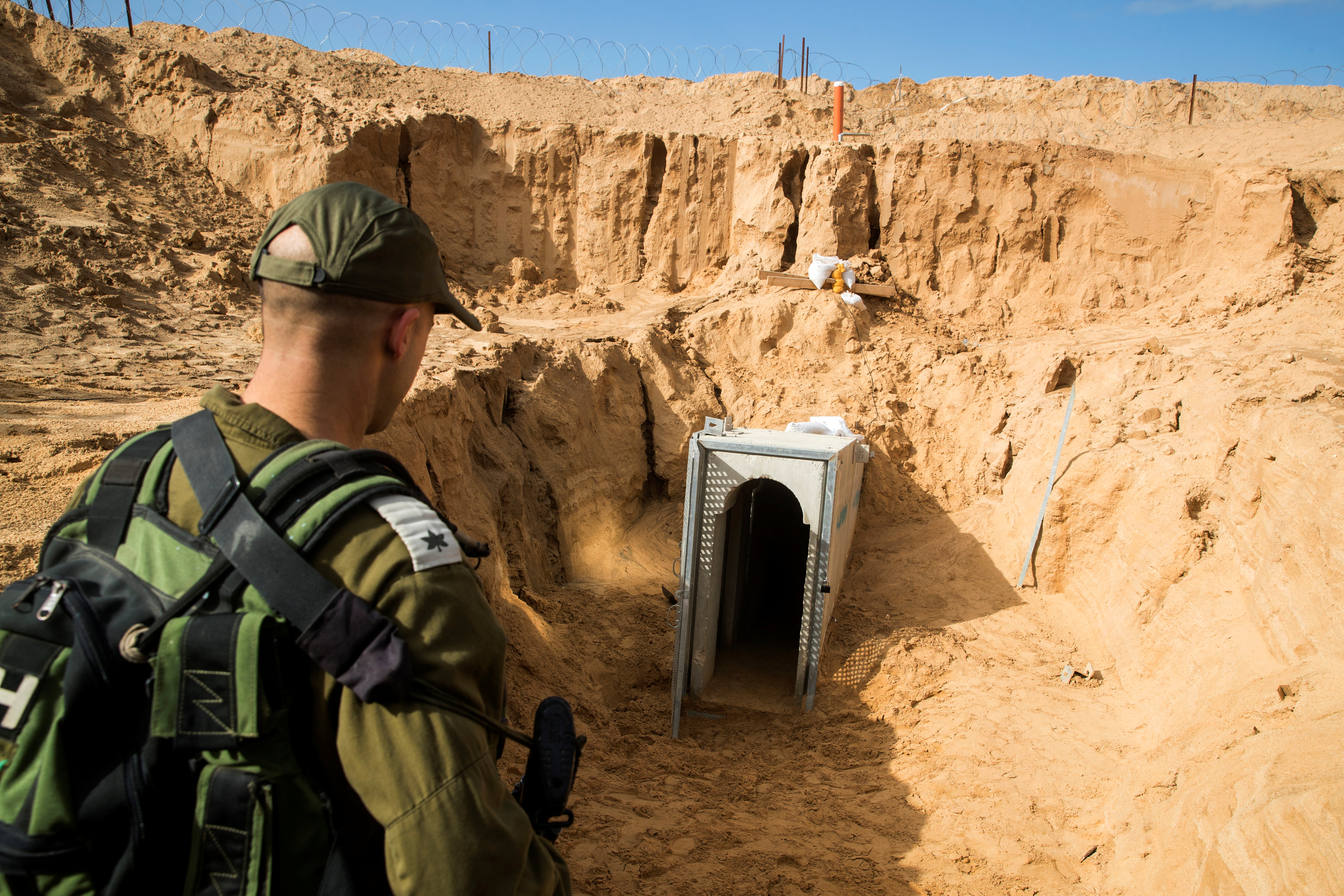 An Israeli soldier stands next to an entrance to what the Israeli military say is a cross-border attack tunnel dug from Gaza to Israel, on the Israeli side of the Gaza Strip border near Kissufim, Israel January 18, 2018