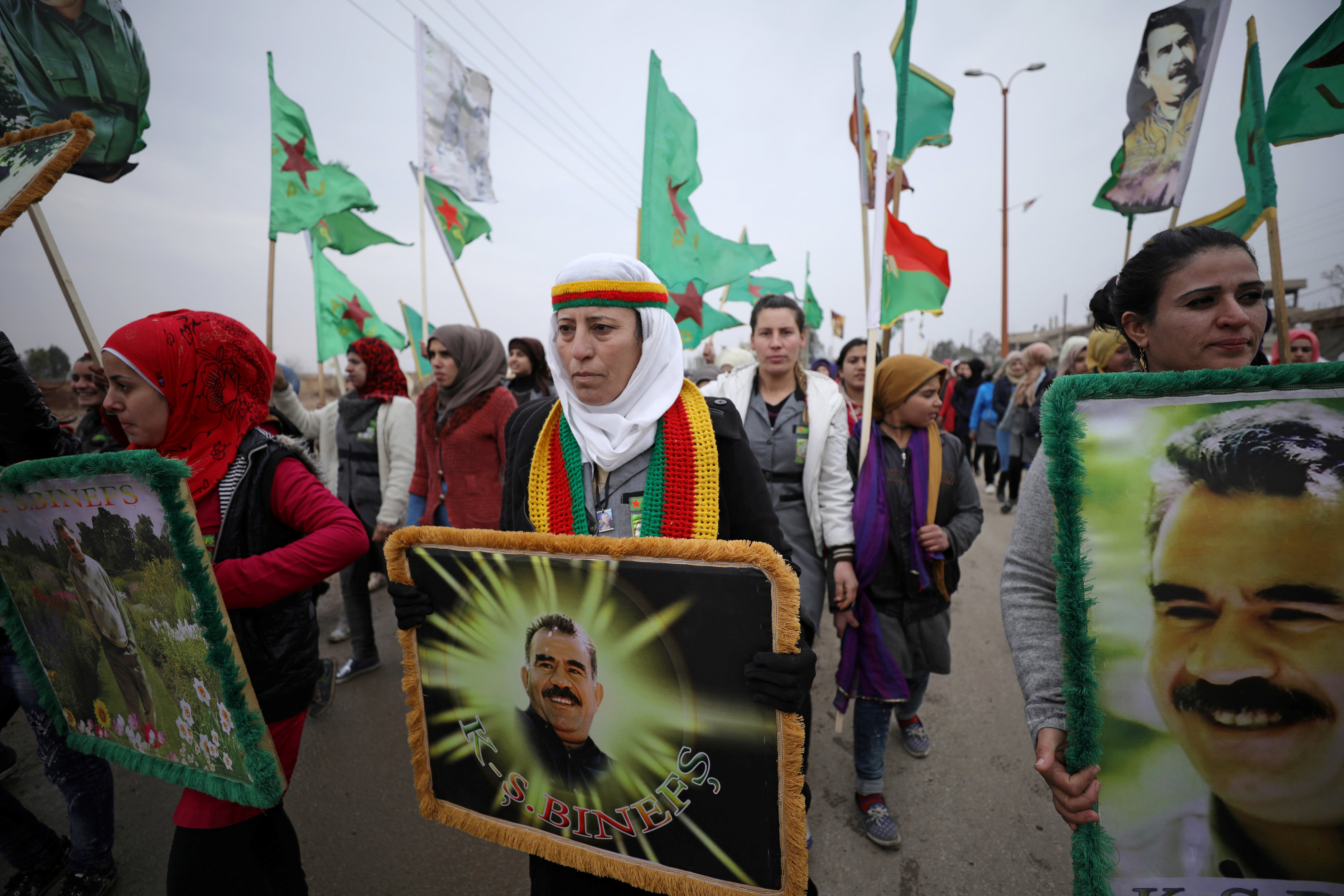 A woman holds a picture of Kurdish leader Abdullah Ocalan of the Kurdistan Workers Party (PKK) during a protest against Turkish attacks on Afrin, in Hasaka province, Syria, January 18, 2018.