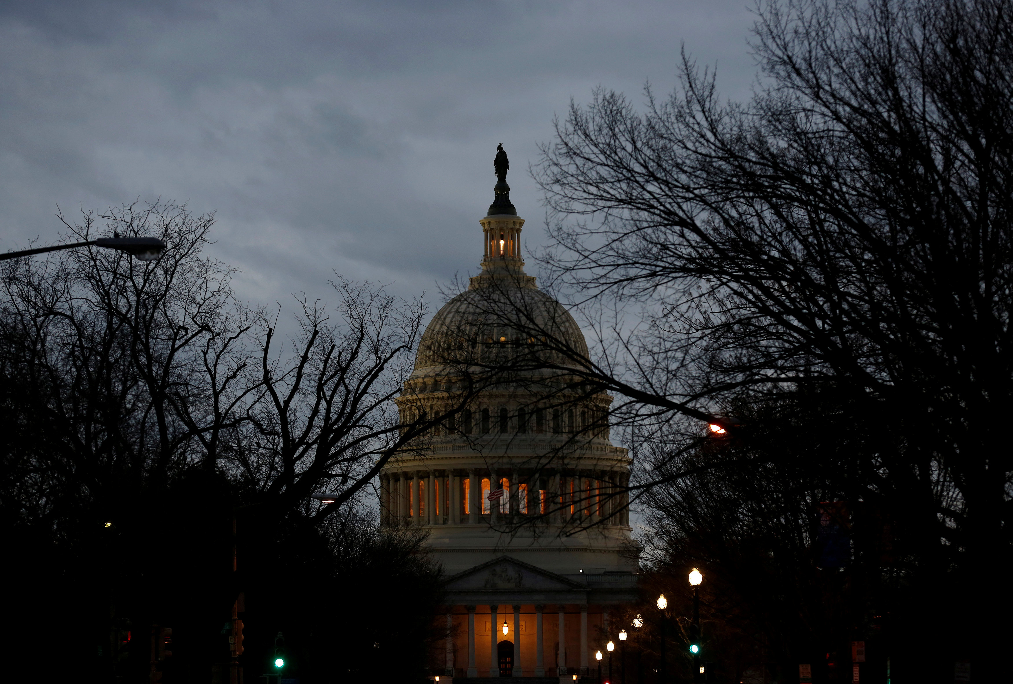 The U.S. Capitol is lit during the second day of a shutdown of the federal government in Washington, U.S., January 21, 2018.