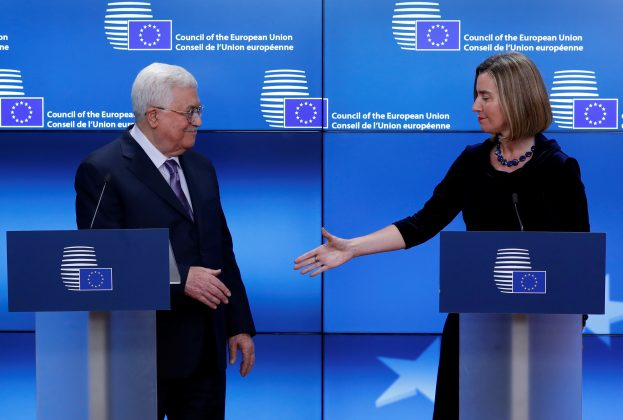 European High Representative for Foreign Affairs Federica Mogherini shakes hands with Palestinian President Mahmoud Abbas in Brussels, Belgium, January 22,