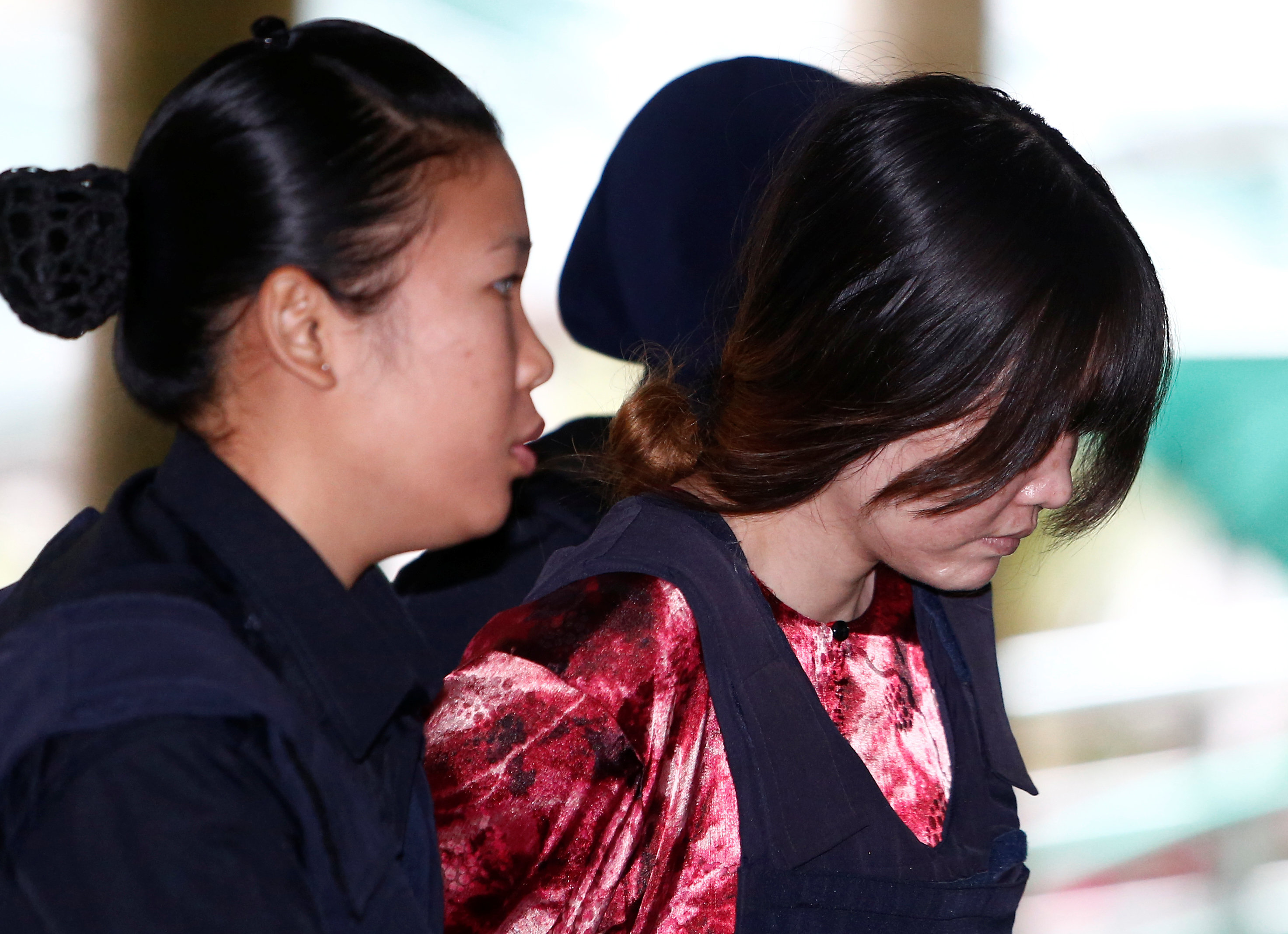 Vietnamese Doan Thi Huong, who is on trial for the killing of Kim Jong Nam, the estranged half-brother of North Korea's leader, is escorted as she arrives at the Shah Alam High Court on the outskirts of Kuala Lumpur, Malaysia January 22, 2018.