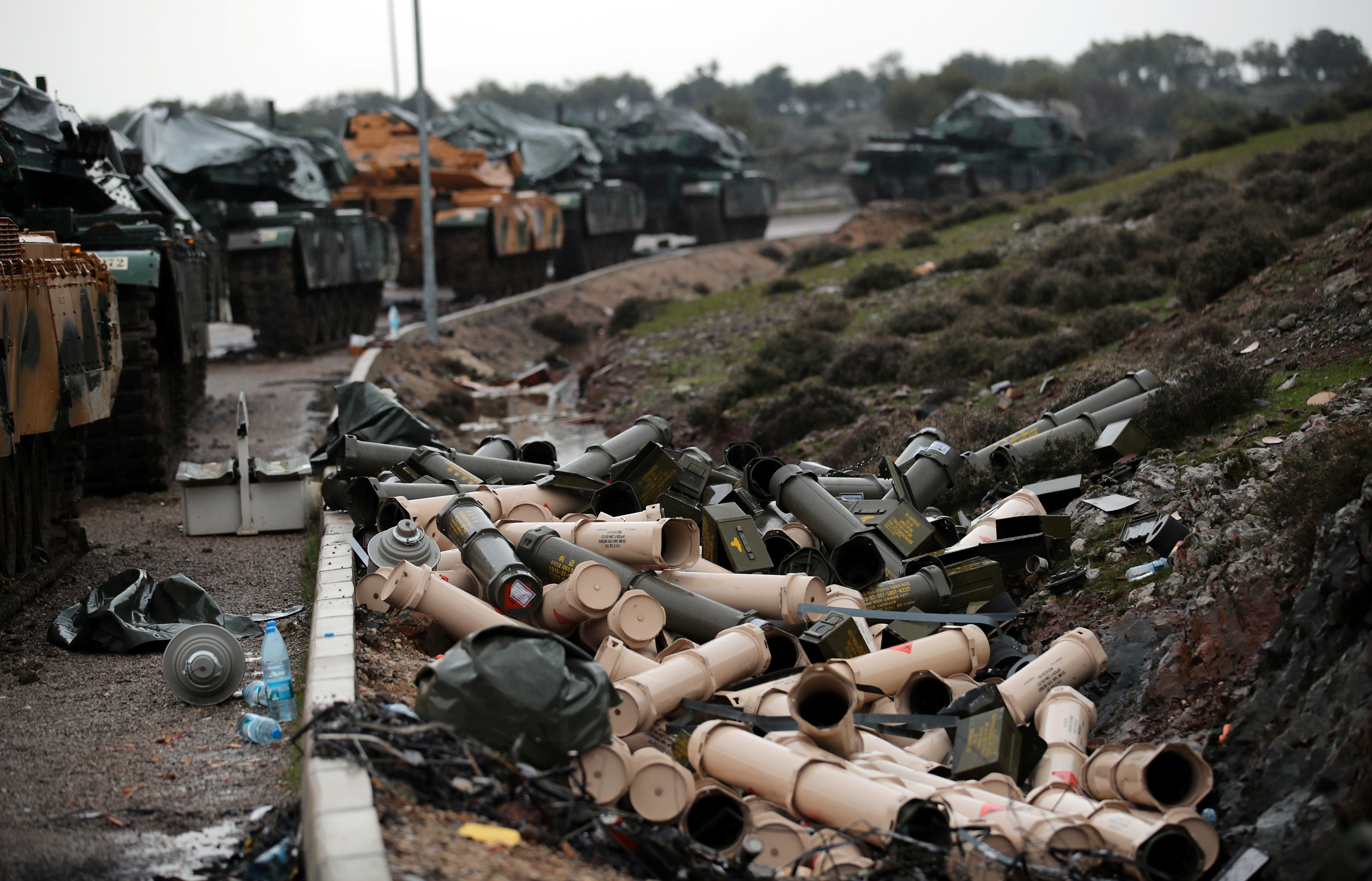 Empty shells are seen next to Turkish army tanks on the Turkish-Syrian border in Hatay province, Turkey January 23, 2018.