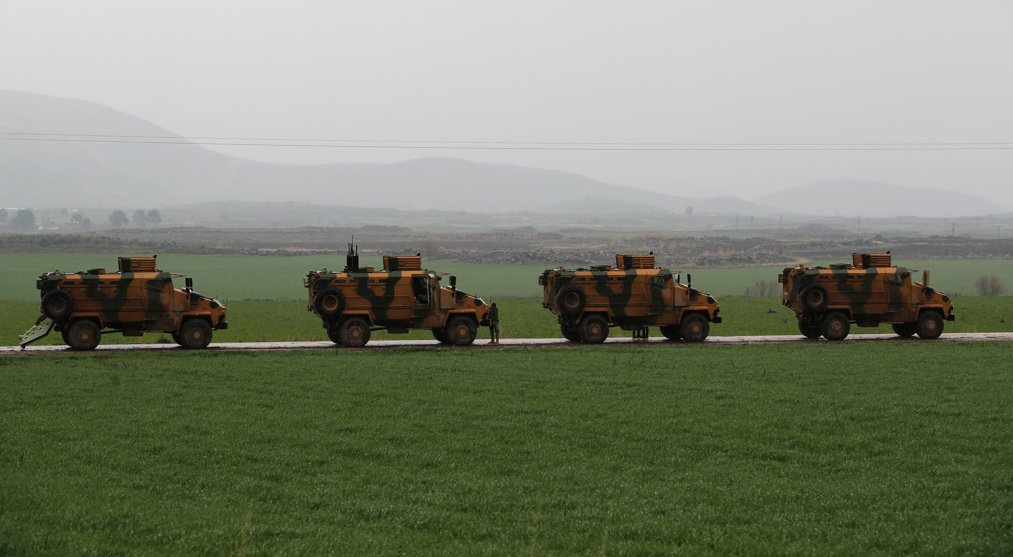 Turkish army vehicles are pictured near the Turkish-Syrian border in Hatay province, Turkey January 23,