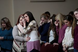 Students attend a prayer vigil for students killed and injured after a 15-year-old boy opened fire with a handgun at Marshall County High School, at Life in Christ Church in Marion, Kentucky, U.S., January 23, 2018.