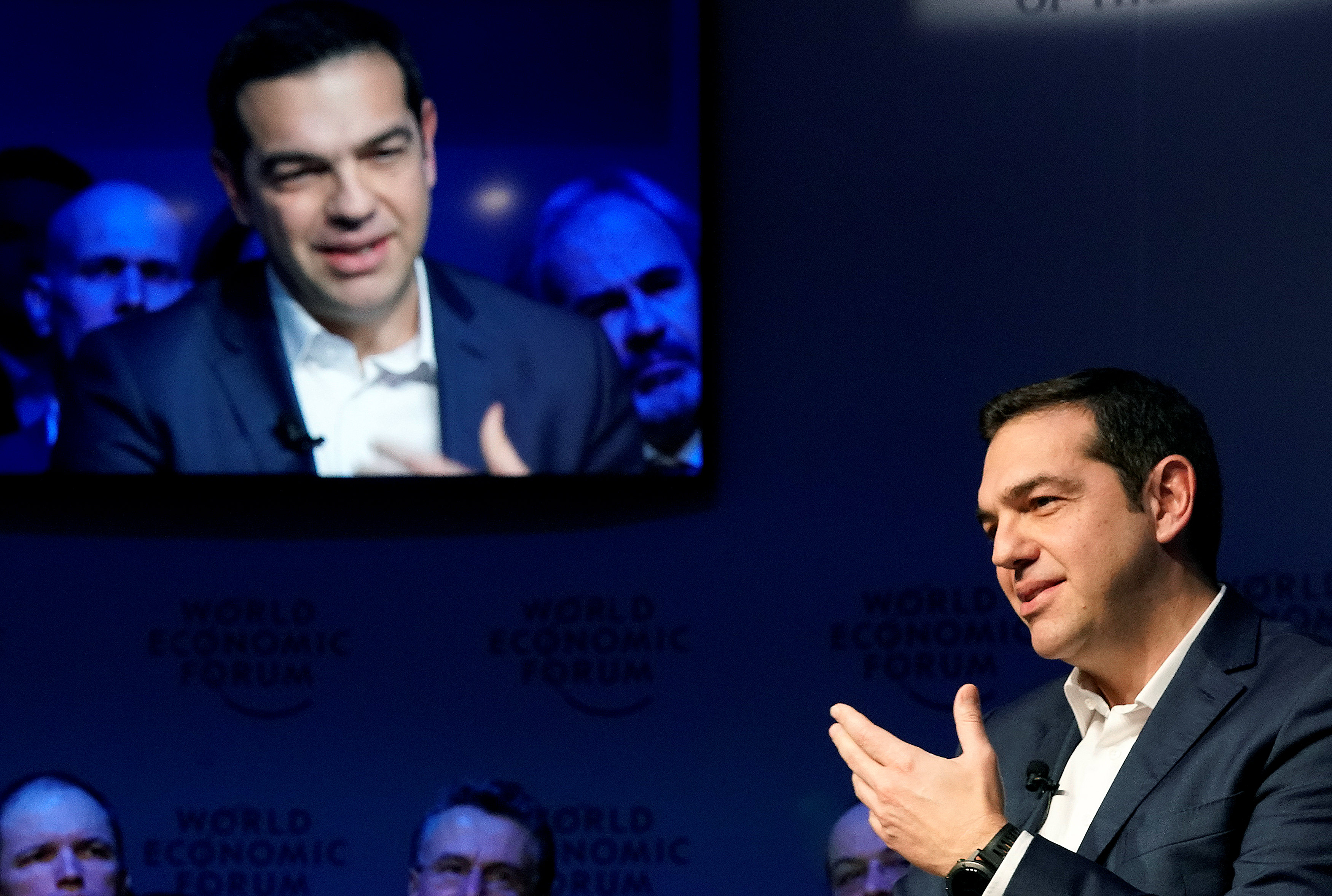 Greece's Prime Ministers Alexis Tsipras gestures as he speaks during the World Economic Forum (WEF) annual meeting in Davos, Switzerland January 24, 2018.