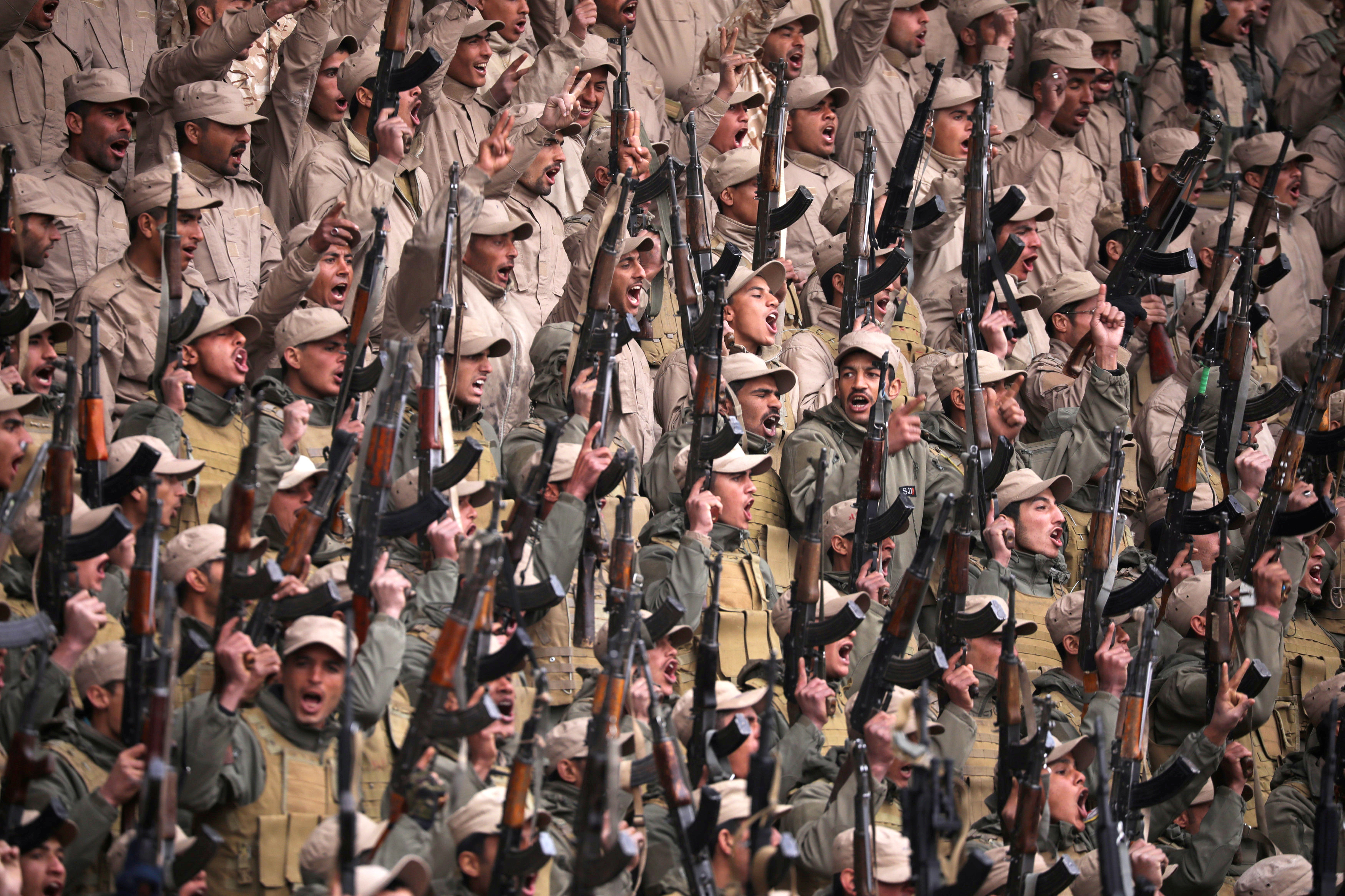 Fighters from the self-defence forces of the Kurdish-led north hold their weapons during a rally in Hasaka, northeastern Syria. REUTERS/Rodi Said