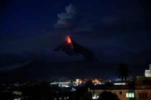 Lava flows from the crater of Mount Mayon volcano during a new eruption in Legazpi city, Albay province, Philippines January 25,