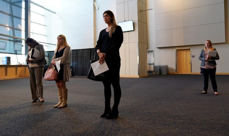 Job seekers listen to a presentation at the Colorado Hospital Association job fair in Denver, Colorado, U.S., October 4, 2017.