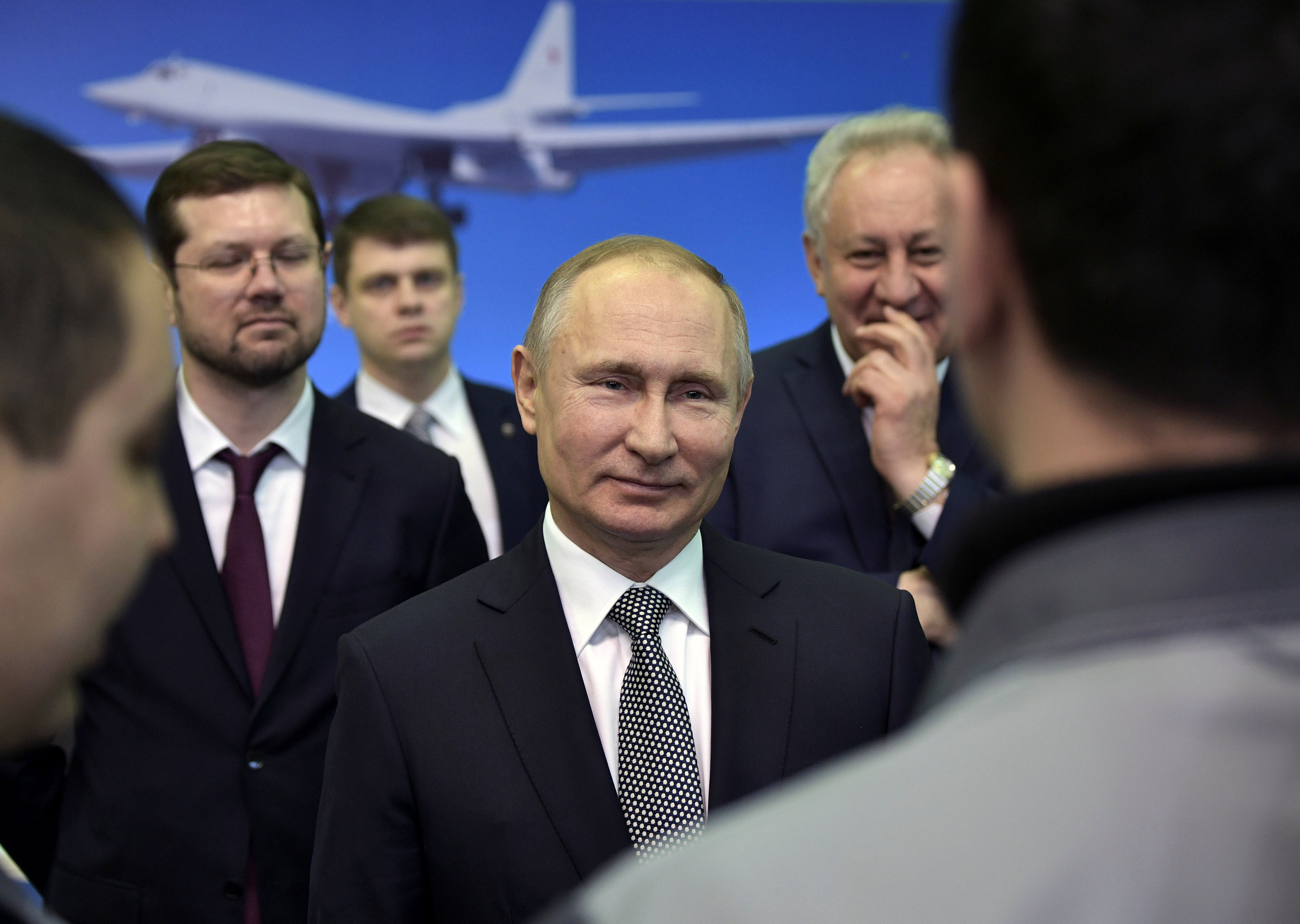 Russian President Vladimir Putin meets with employees during a visit to the Gorbunov Aviation factory in Kazan, Russia January 25, 2018. Sputnik/Alexei Nikolsky/Kremlin via