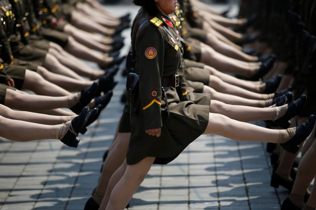 North Korean soldiers march during a military parade marking the 105th birth anniversary of the country's founding father Kim Il Sung in Pyongyang, North Korea.
