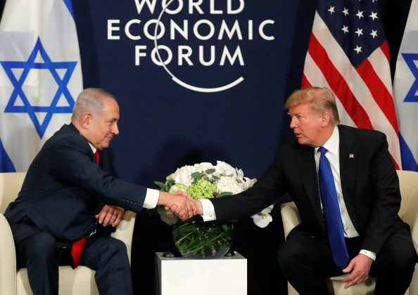 U.S. President Donald Trump shakes hands with Israeli Prime Minister Benjamin Netanyahu during the World Economic Forum (WEF) annual meeting in Davos, Switzerland January 25, 2018