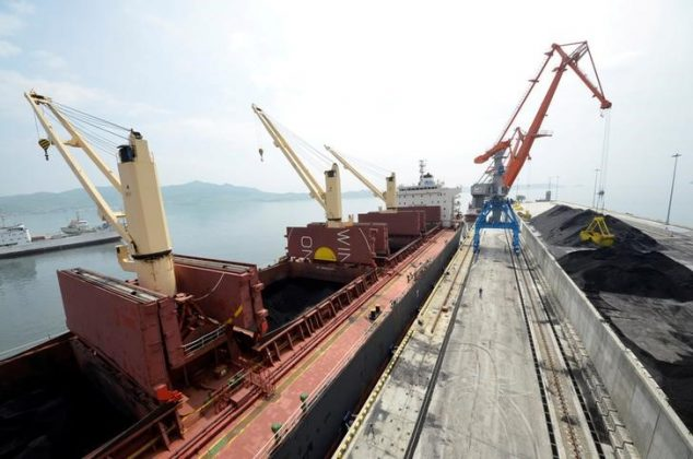 A cargo ship is loaded with coal during the opening ceremony of a new dock at the North Korean port of Rajin July 18, 2014.