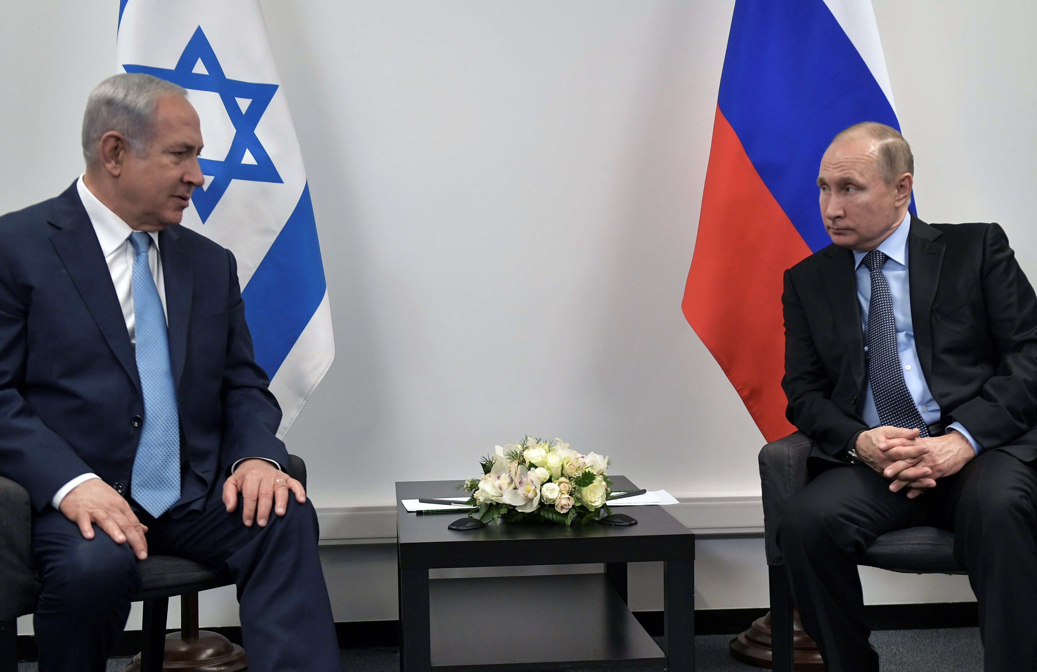 Russian President Vladimir Putin and Israeli Prime Minister Benjamin Netanyahu attend a meeting at the Jewish Museum and Tolerance Centre in Moscow, Russia January 29, 2018.