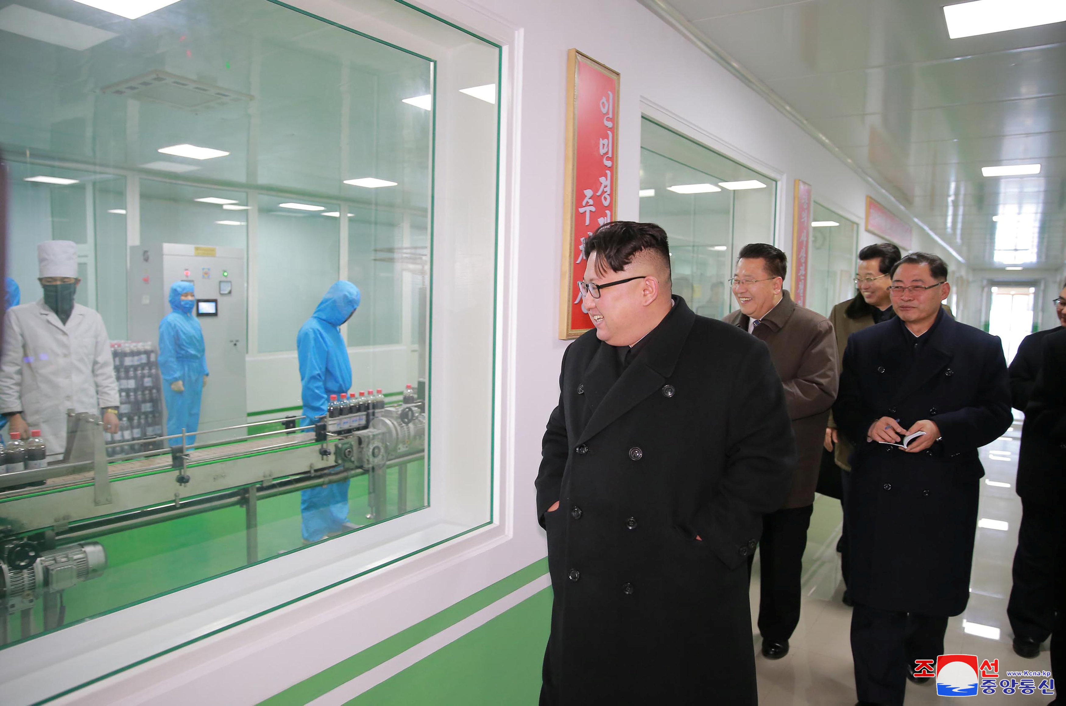 North Korean leader Kim Jong Un gives field guidance at the Pyongyang Pharmaceutical Factory, in this undated photo released by North Korea's Korean Central News Agency (KCNA) in Pyongyang January 25, 2018.