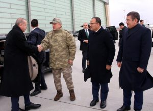 Turkish President Tayyip Erdogan is welcomed by Chief of the General Staff Hulusi Akar, Deputy Prime Minister Bekir Bozdag and Defence Minister Nurettin Canikli upon his arrival at the border city of Hatay, Turkey January 25, 2018.