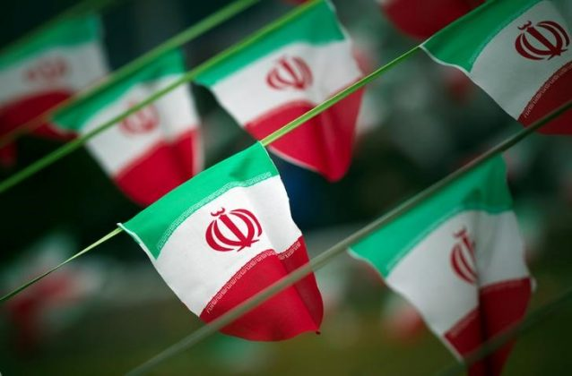 Iran's national flags are seen on a square in Tehran February 10, 2012, a day before the anniversary of the Islamic Revolution.