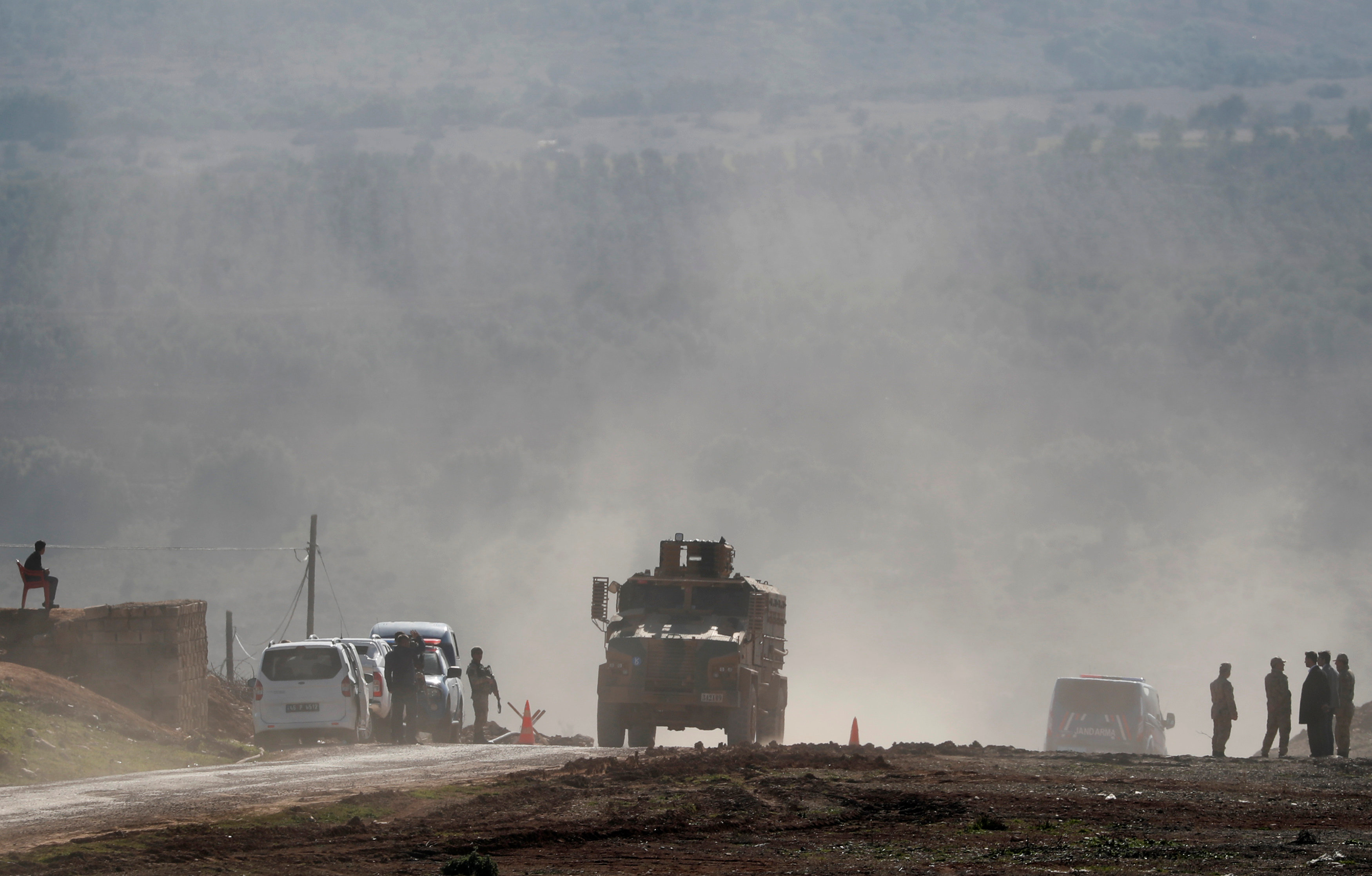 A Turkish Army vehicle leaves from a military post near the Turkish-Syrian border in Kilis province, Turkey January 31, 2018.