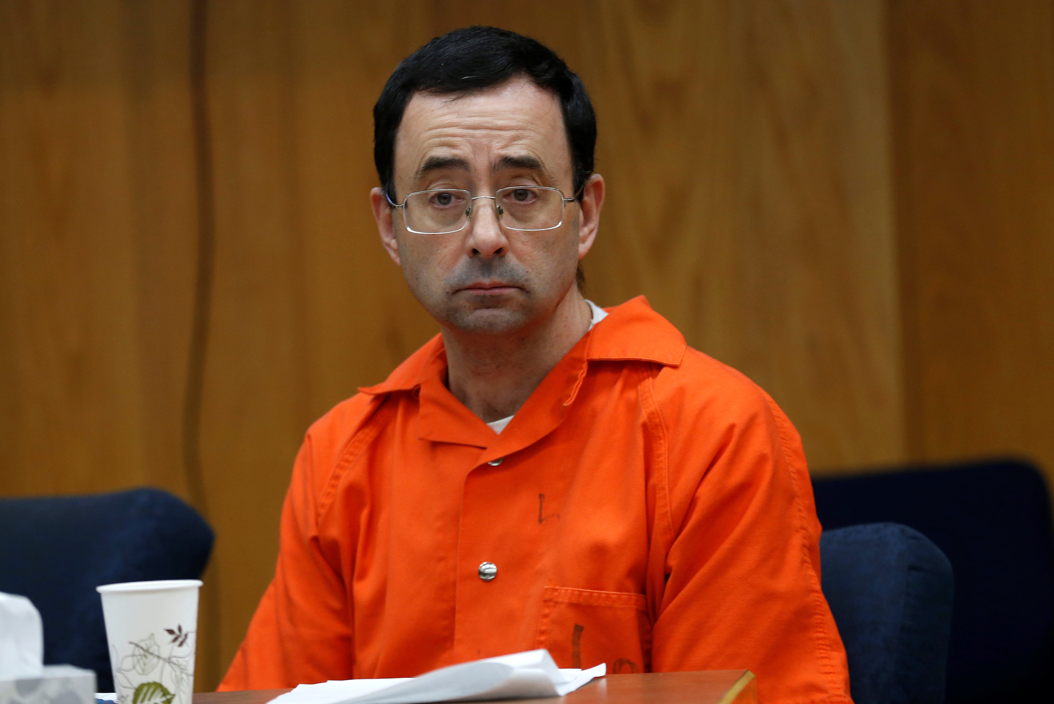 Larry Nassar, a former team USA Gymnastics doctor who pleaded guilty in November 2017 to sexual assault, listens to victims impact statements during his sentencing in the Eaton County Circuit Court in Charlotte, Michigan, U.S., January 31, 2018.