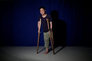 North Korean defector Ji Seong-ho, 35, poses for a photograph leaning on the crutches he used when he defected, in Seoul, South Korea, August 13, 2017