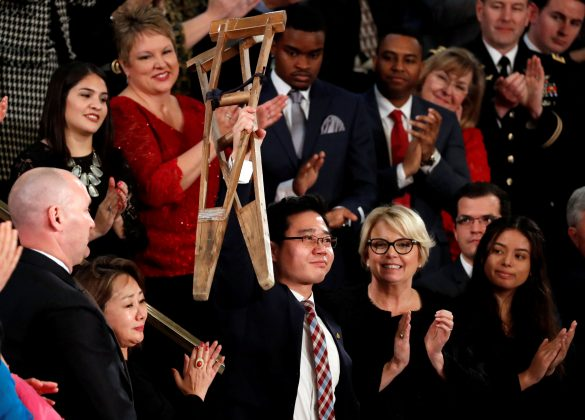 North Korean defector Ji Seong-ho, currently a law student at Dongguk University, holds up his crutches during U.S. President Donald Trump's State of the Union address to a joint session of the U.S. Congress on Capitol Hill in Washington, U.S. January 30, 2018.