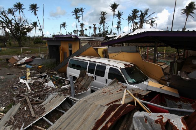 A car is partially buried under the remains of a building, after Hurricane Maria hit the island in September, in Humacao, Puerto Rico January 25, 2018.