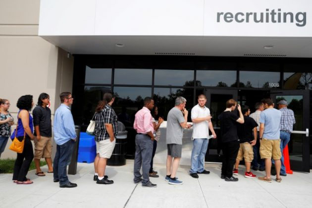 "Job seekers line up to apply during ""Amazon Jobs Day,"" a job fair being held at 10 fulfillment centers across the United States aimed at filling more than 50,000 jobs, at the Amazon.com Fulfillment Center in Fall River, Massachusetts, U.S., August 2, 2017."