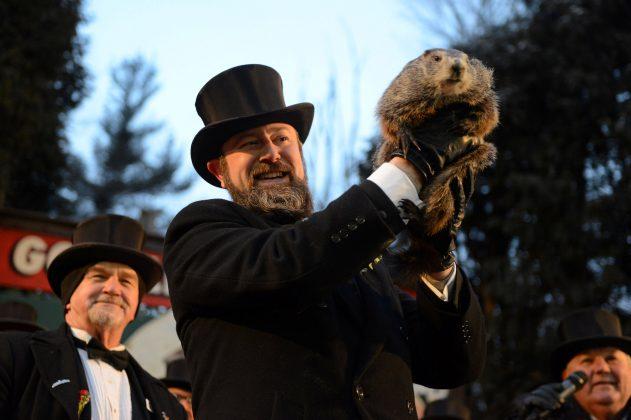 Groundhog co-handler A.J. Derume holds Punxsutawney Phil at Gobbler's Knob on the 132nd Groundhog Day in Punxsutawney, Pennsylvania, U.S. February 2, 2018. REUTERS/Alan Free