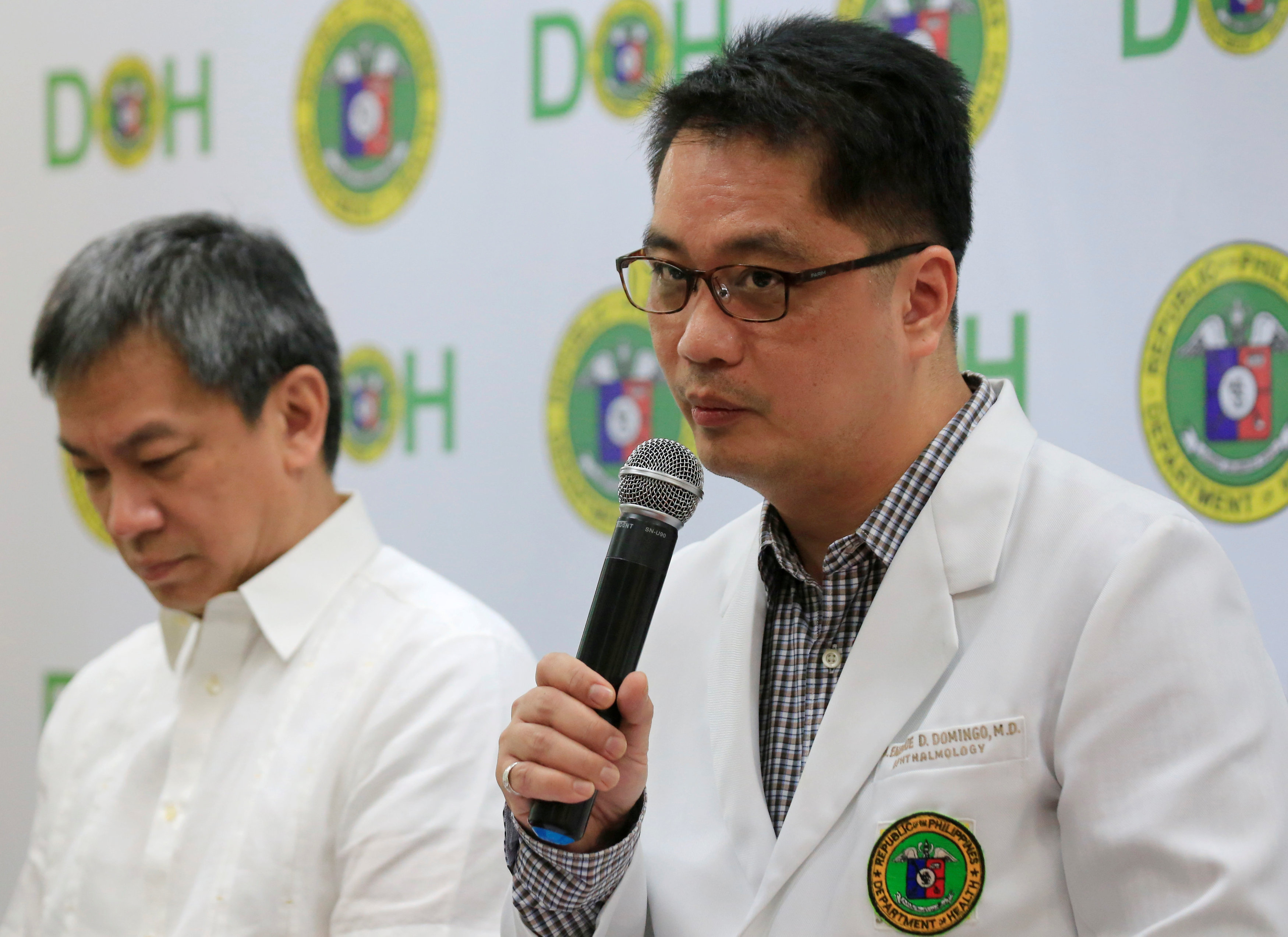 Dr. Rolando Enrique Domingo (R), Undersecretary of the Department of Health (DOH), with Dr. Gerardo Legaspi, Director of the Philippine General Hospital (PGH), answer questions during a news conference at the DOH headquarter in metro Manila, Philippines February 2, 2018.