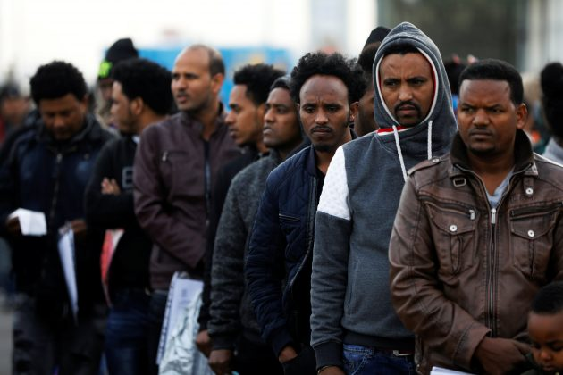 African migrants wait in line for the opening of the Population and Immigration Authority office in Bnei Brak, Israel February 4, 2018. Picture taken February 4, 2018