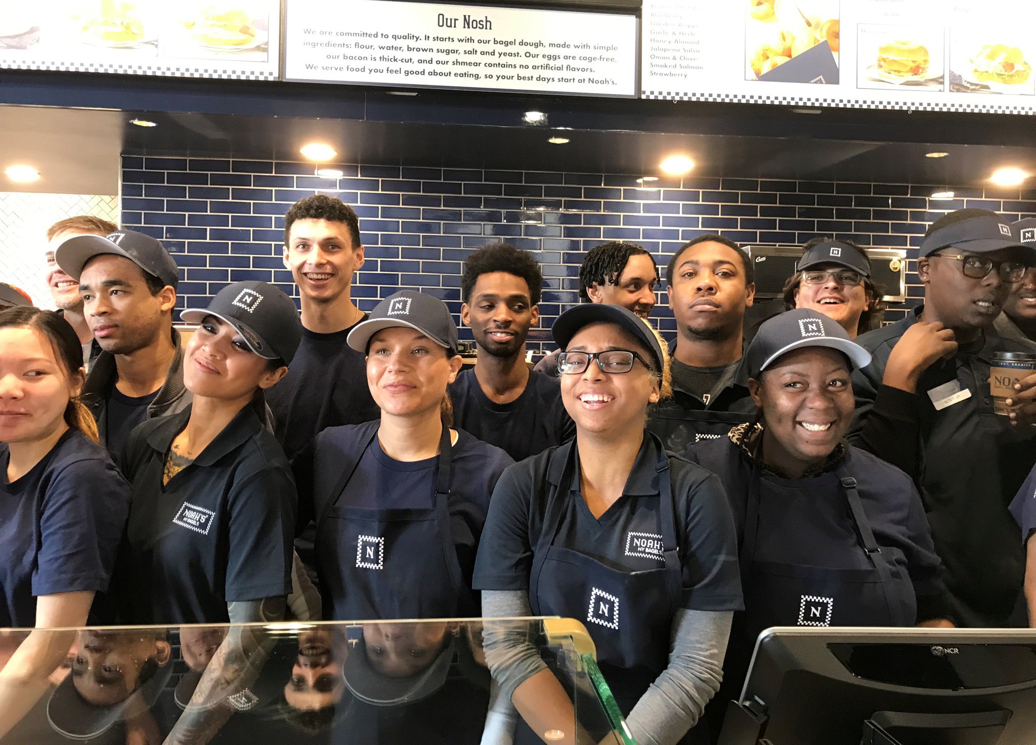 Newly hired employees take a break from training to pose for a group photo at the chain's soon-to-open 54th outlet in Oakland, California ,U.S., January 24, 2018.